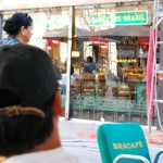 BARCELONA, SPAIN—THE outlet of the popular Brazilian coffee shop Bracafe in Paloma district is Filipinos' favourite hangout, like this gentleman in a cap. (OFW Journalism Consortium)