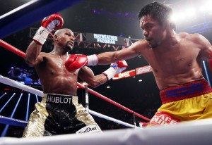 May 2, 2015 was the day when two phenomenal boxers, Floyd Mayweather, Jr. and Manny Pacquiao, brandished boxing's post-modern era in a big-time fight. Mayweather won, but the global thrill that these boxers' phenomenal talents had created is about to end (Photo by Chris Farina of Top Rank)