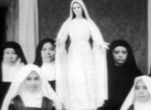 """The Discalced Carmelite community with the original miraculous image of Mary Mediatrix of All Grace ( Mother Mary Cecilia of Jesus on the left side of Our Lady while the visionary Sister Teresita Castillo on the right hand side of Our Lady). Some 67 years after, the Lipa Archdiocese had affirmed the 1948 apparitions as 'worthy of belief' (photo from the Facebook page """"Our Lady, Mary Mediatrix of All Grace"""")"""