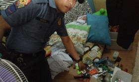 A cop of a municipal police force in Batangas province shows evidence of drug paraphernalia collared during a buy-bust operation.