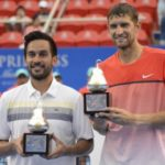 Filipino tennis ploayer Treat Conrad Huey and partner Max Mirnyi of Belarus reached the finals of this year's Wimbledon. Both are shown here in this file photo when they ruled the Acapulso Open earlier this March in Mexico (photo by ____________,).