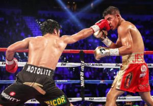 Pacquiao connects on a right to Jessie Vargas' face. Stand-alone right jabs and straights, not just the right hits that prep up his left hand killer punch, were noticeably Pacquiao's new weapons (photo from Top Rank Boxing)