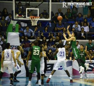 Jeron Teng (right, in the air) and Ben Mbala steered the DLSU Green Archers to this year's UAAP title by sweeping the best-of-three series against the Ateneo de Manila Blue Eagles (photo by RJ Quiroz of Rektikano.net)