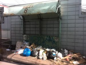 Uncollected trash at a waiting shed in Lipa City's Barangay 8 (photo by Connie Reyes-Raz through her Facebook account)