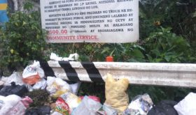 The tarpaulin at an area of J. P. Laurel National Highway in Lipa City is clear: throwing trash in this public spot is strictly prohibited. What is also clear is that residents, whether living within or outside of Lipa City, have wanton disregard for this warning coming from barangay officials. Lipa's city- and barangay-level officials  ar enow feeling the heat of what to do with growing garbage. (photo from Marlon Alexander Luistro / The Filipino Connection)