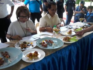 The country's irst Quail Festival held Sept. 29 in Lipa City also had a 90-minute cooking contest. Partcipants were asked to develop delicacies out of quail meat, which judges here (in this photo) tasted their taste. (photo by Marlon Alexander Luistro / The Filipino Connection)