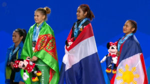 The medalists in the 53 kg. class that include Diaz (right) and reigning Olympic Champion Hsu-Shu Ching of Chinese-Taipei. Hsu did not finish the entire competition but managed a silver in the snatch behind Sopita Tanasan of Thailand (screengrab from www.teamusa.org/usa-weightlifting/live)